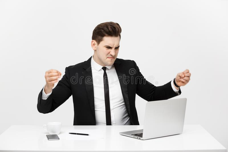 Business Concept: Portrait of screaming angry businessman sitting in office isolated over white background. royalty free stock images