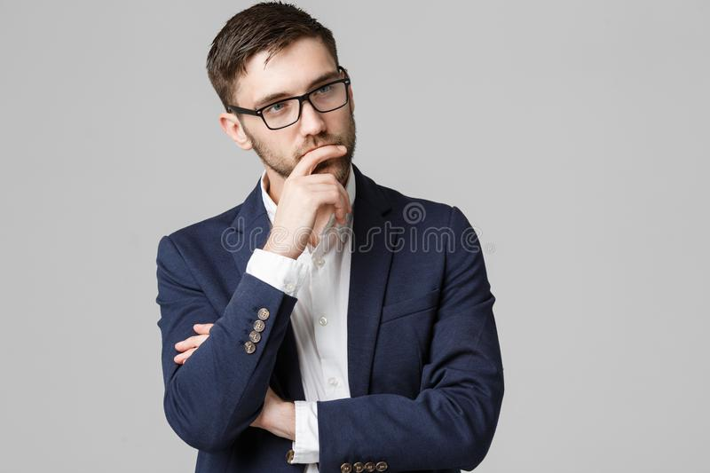 Business Concept - portrait young successful businessman posing over dark background. Copy space. royalty free stock images