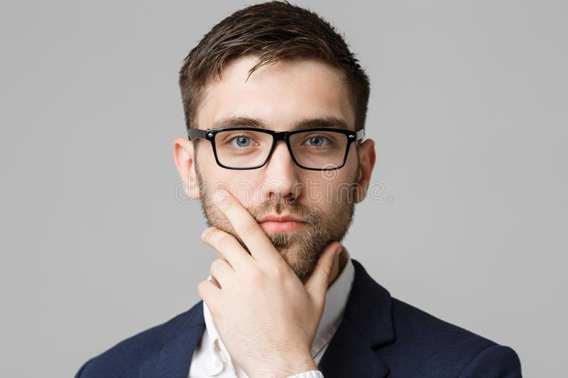 Business Concept - portrait young successful businessman posing over dark background. Copy space. royalty free stock image