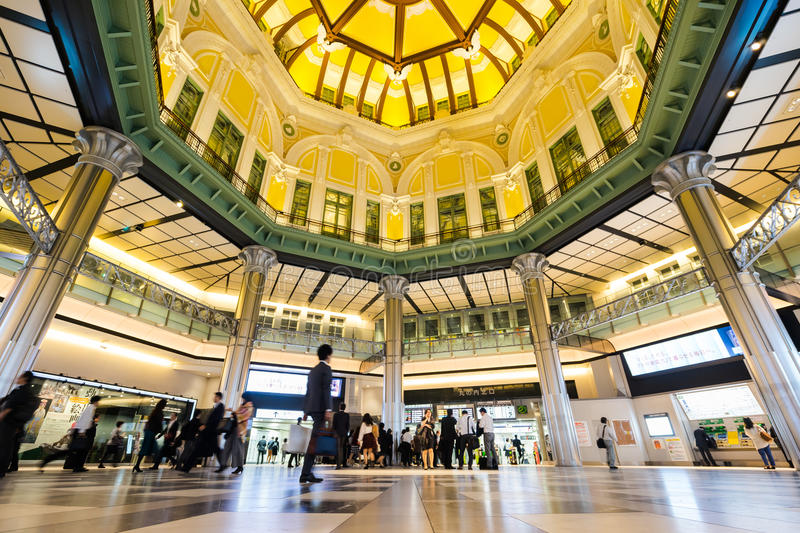 Business concept for real estate and corporate construction - looking up view in tokyo station with crowd of people silhouettes re stock image