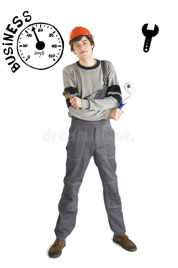 Business concept of self-made man. Young laborer man in orange helmet over white background with sketches. stock images
