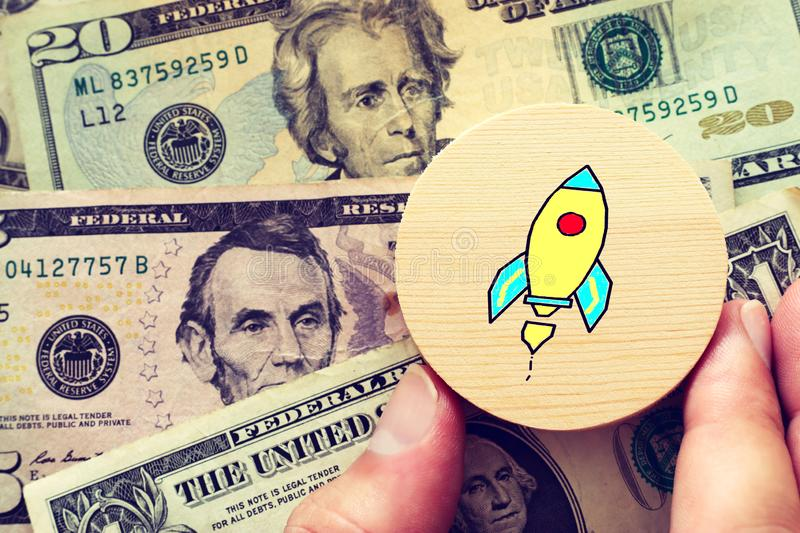 Business concept of stack of money and rocket sketch.  royalty free stock photos