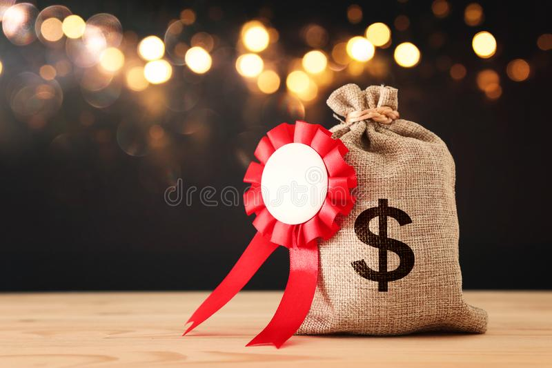 Business Concept of Success, Best Investment and reward for Performance. Money Bag with red rosette Medal royalty free stock photography