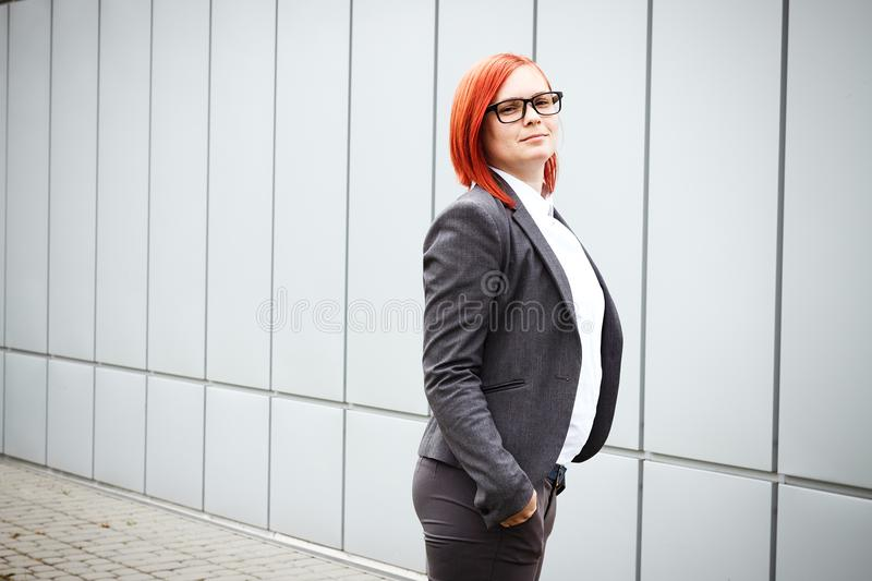 Business concept of success. Serious Successful Woman boss, in a royalty free stock image