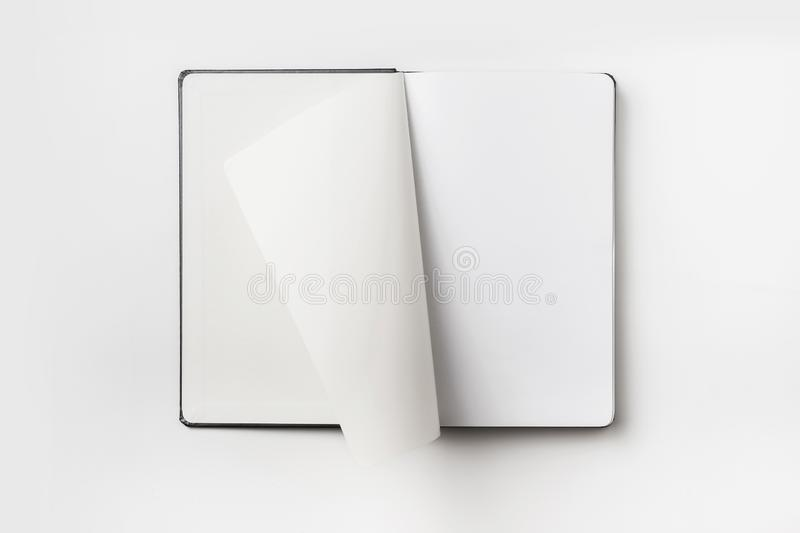 Top view of black notebook with curl rolled page stock images
