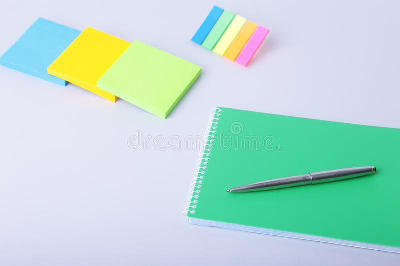 Business concept. Top view of kraft spiral notebook, glasses, smartphone and black pen isolated on background for mockup royalty free stock images