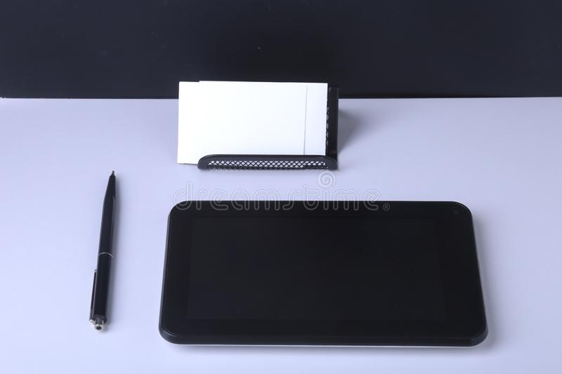 Business concept. Top view of kraft spiral notebook, glasses, smartphone and black pen stock photo