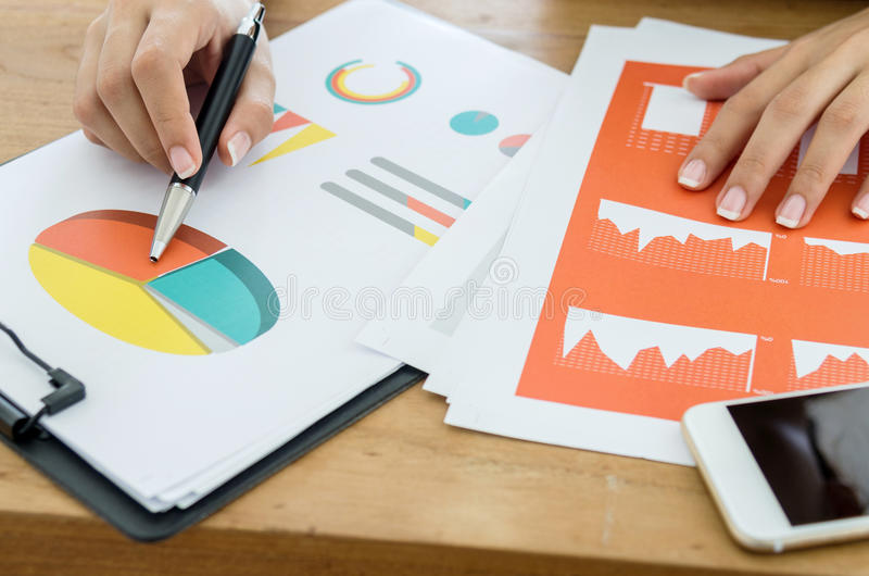 Business concept. Woman making presentation with business document. stock image