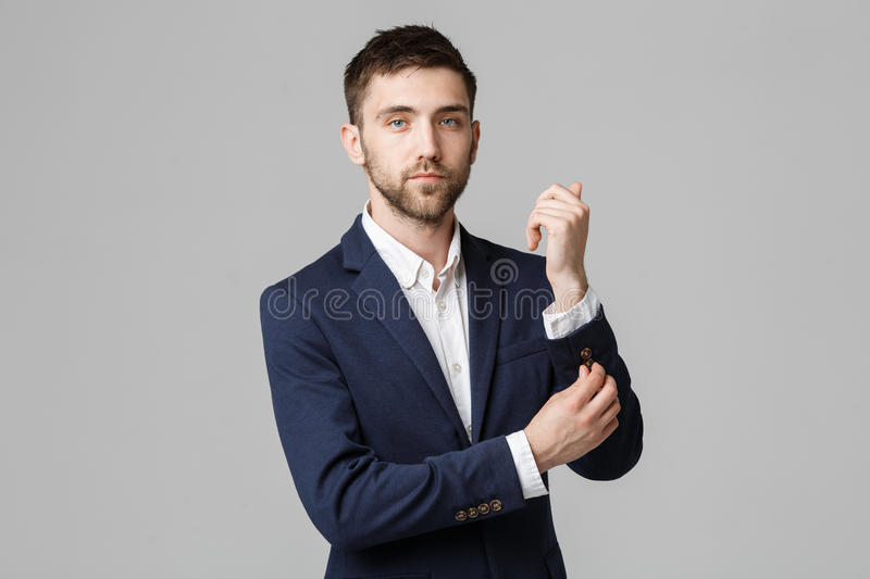 Business Concept - Young successful businessman posing over dark background. Isolated White Background. Copy space. royalty free stock photos