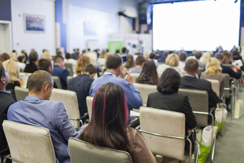 Business Concepts. People At the Conference Listening to Hosts Speakers On Stage. Horizontal Image stock image