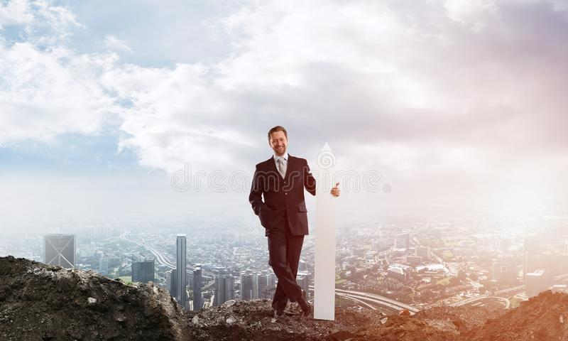 Business conceptual image of businessman in ruins stock photography