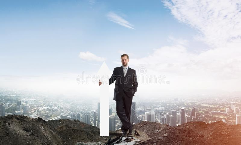 Business conceptual image of businessman in ruins stock photos