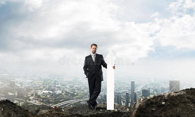 Business conceptual image of businessman in ruins royalty free stock photography