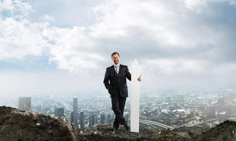 Business conceptual image of businessman in ruins stock images