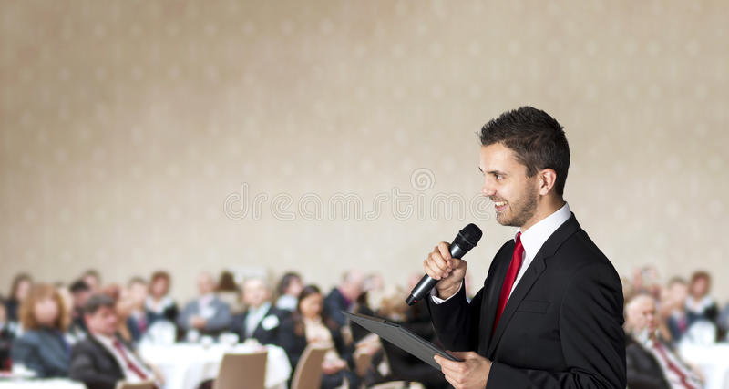Business conference. Man is speaking on indoor business conference for managers royalty free stock photography