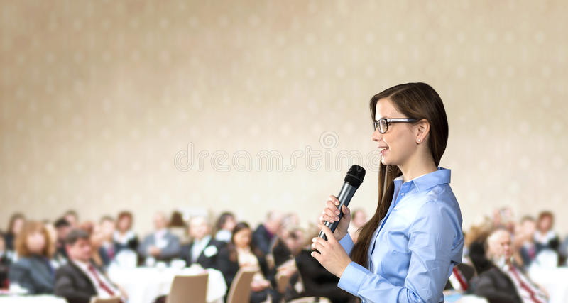 Business conference. Beautiful business woman is speaking on conference royalty free stock photo
