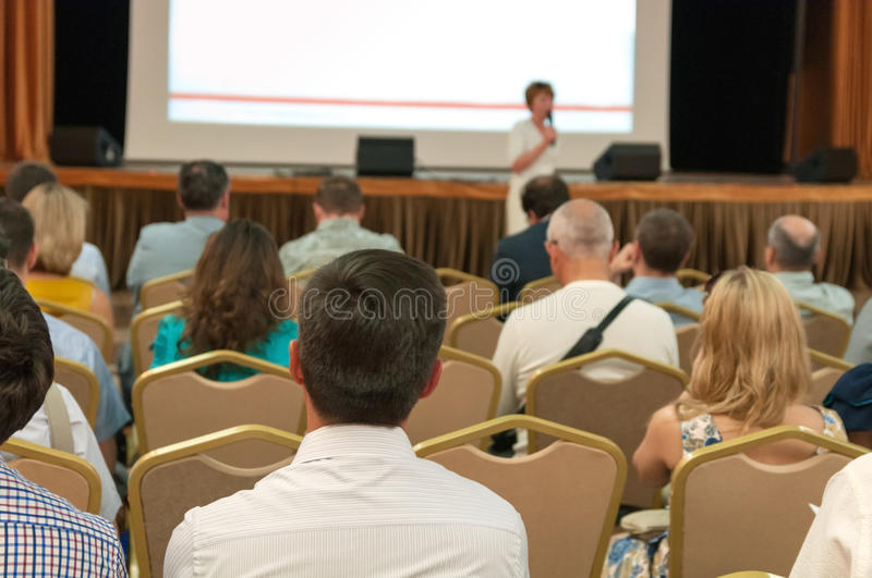 Business conference. People sitting rear at the business conference royalty free stock images