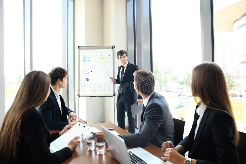 Business conference presentation with team training flipchart office. Business conference presentation with team training flipchart office stock images