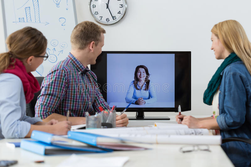 Business conference on the skype. Office workers during business conference on the skype stock photo