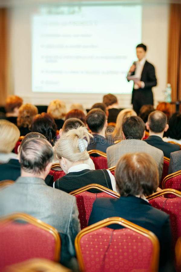 Business conference with speaker and audience royalty free stock photography