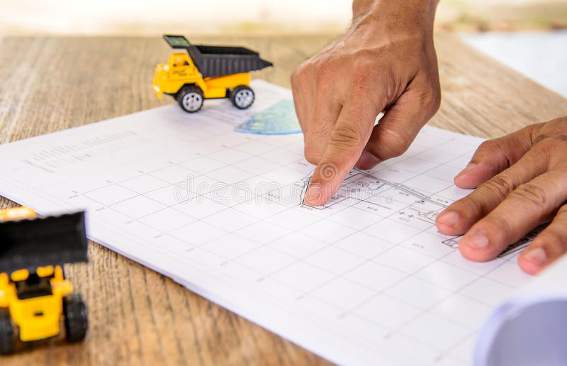 business, Construction drawings on blueprint architectural concept. stock images