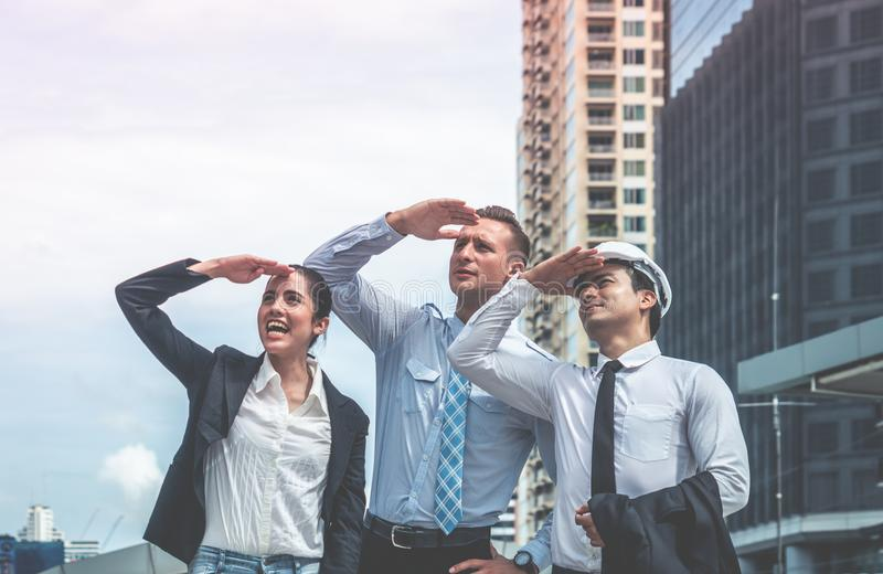 Business construction team looking at future city modern buil. Business construction team is looking at future city modern building with confident royalty free stock image