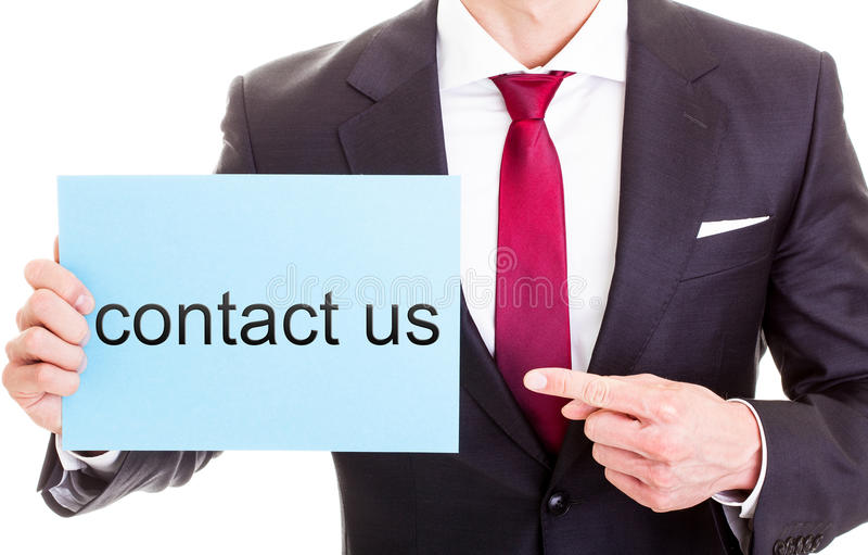 Business contact us sign. Body of a businessman pointing at a contact us sign with a white studio background stock photos