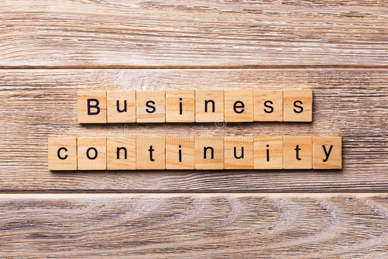Business Continuity word written on wood block. Business Continuity text on wooden table for your desing, concept stock photos