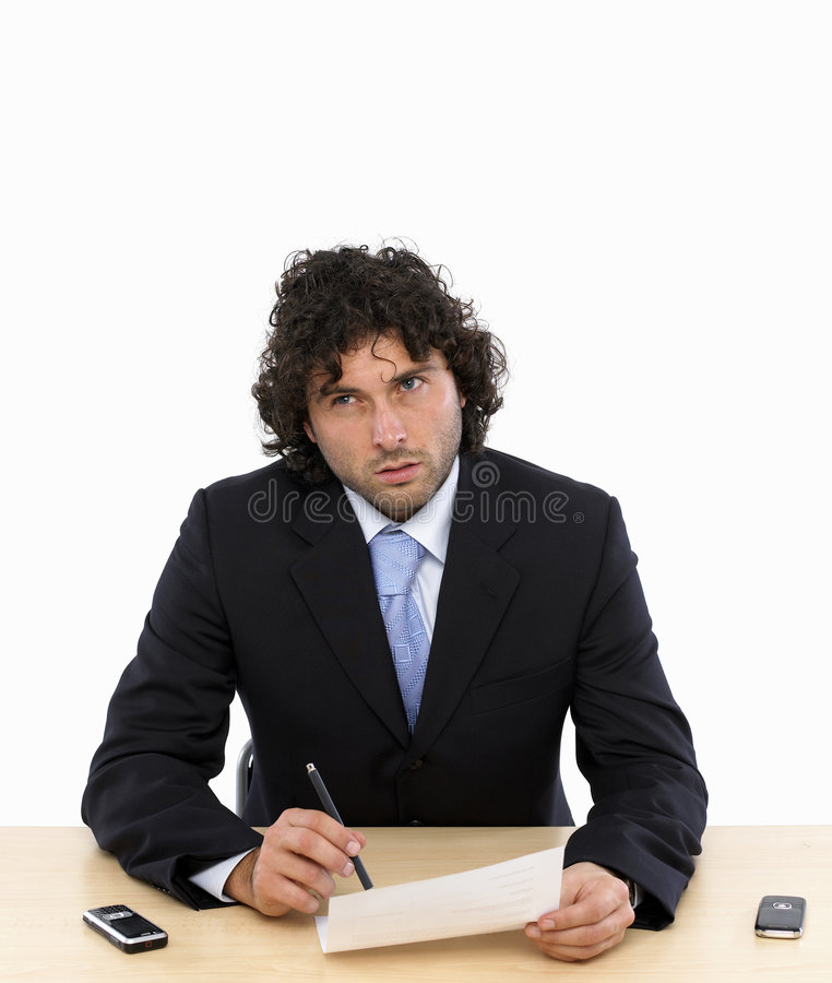 Business contract. Young businessman is writing a contract thinking about royalty free stock photo