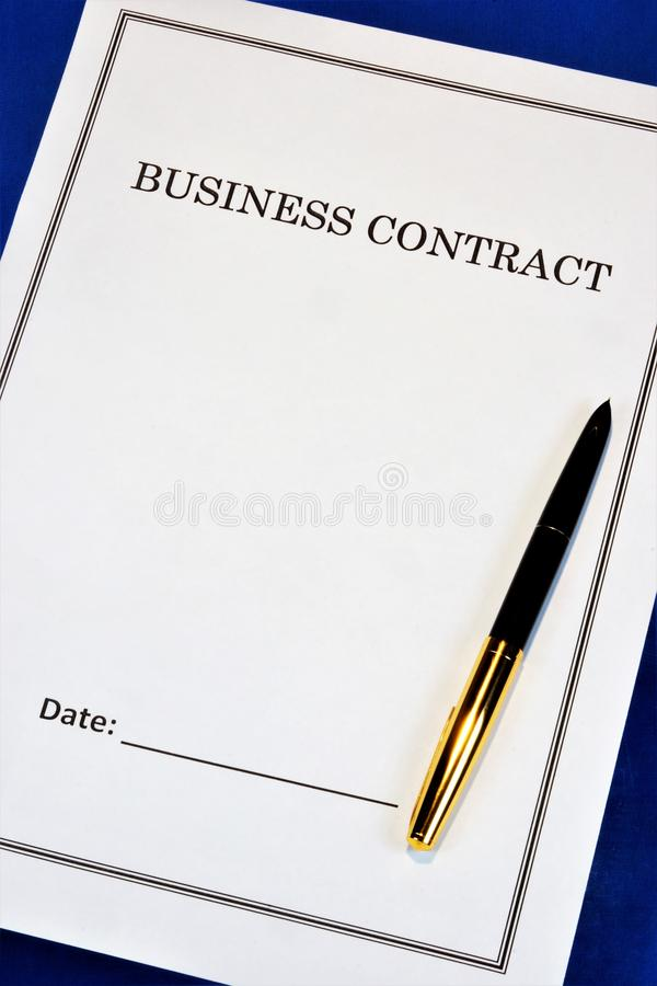 Business contract - financial profit, successful office strategy. On the desktop, the pen, the form of the document to be signed. Based on the analysis of the royalty free stock image