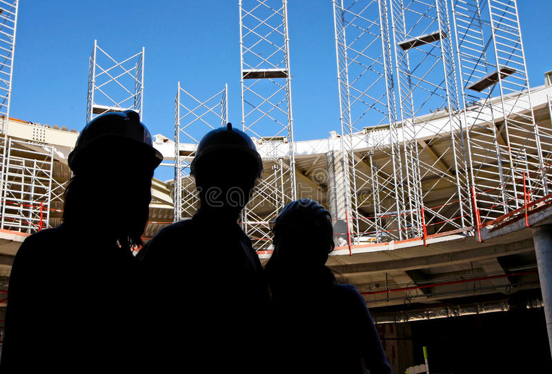 Contractors on construction site royalty free stock image