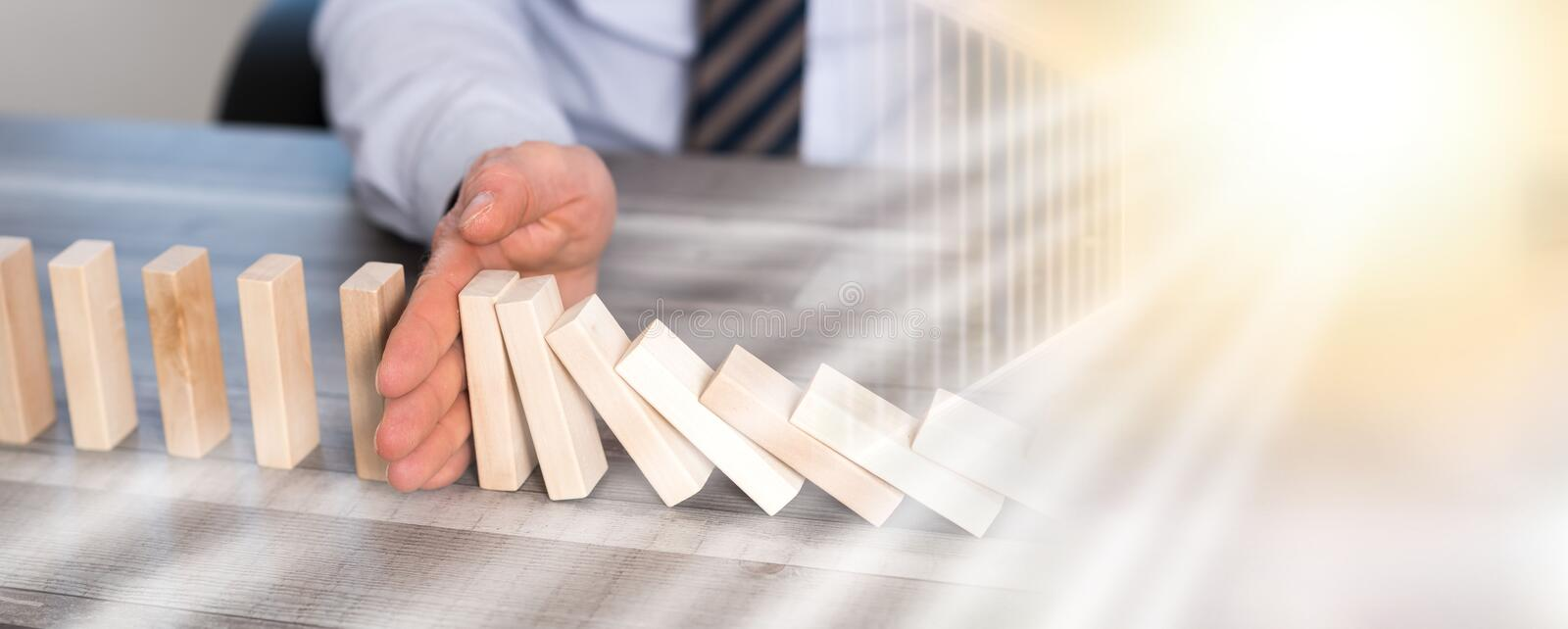 Concept of business control by stopping domino effect; multiple exposure royalty free stock photo