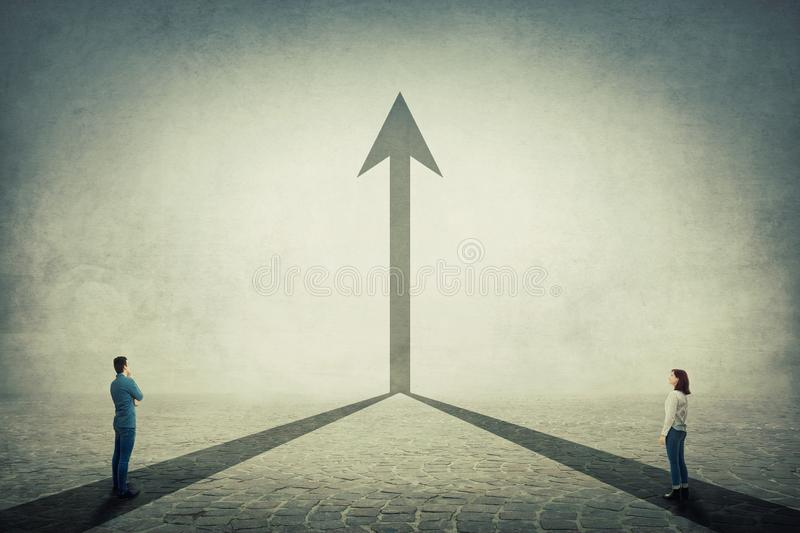 Business cooperation. Young man and woman pathway join together and transform into a straight arrow going up. Business cooperation and partnership, sharing stock images