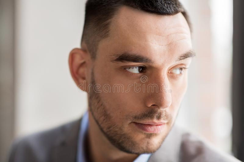 Portrait of businessman in suit at office royalty free stock image