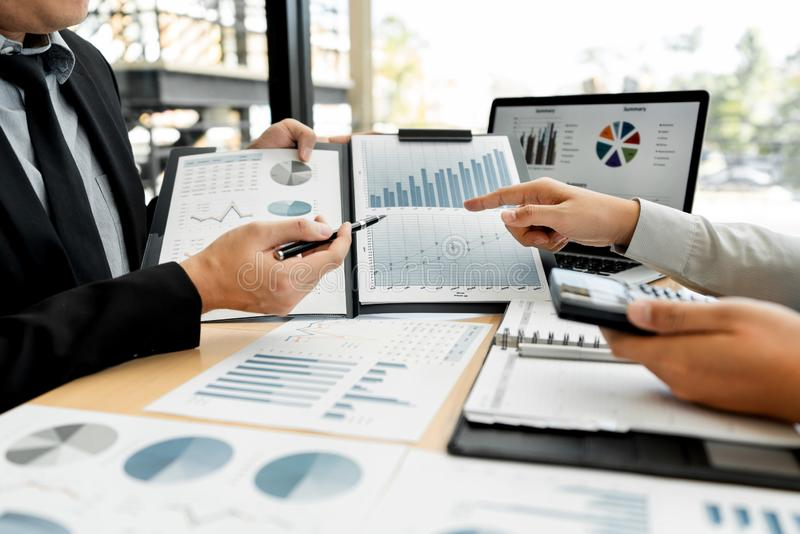 Business Corporate team brainstorming, Planning Strategy having a discussion Analysis investment researching with chart at office stock image