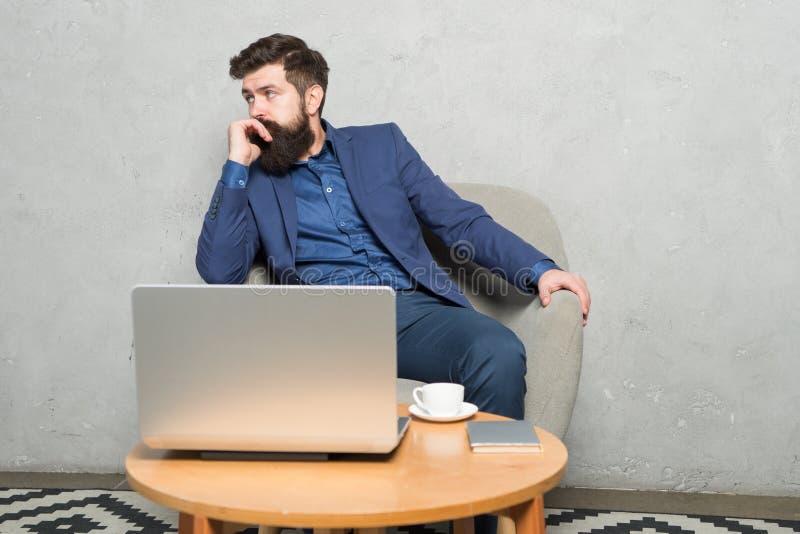 Business correspondence. Modern businessman. Businessman work laptop. Man drink coffee in business office. Responding stock image