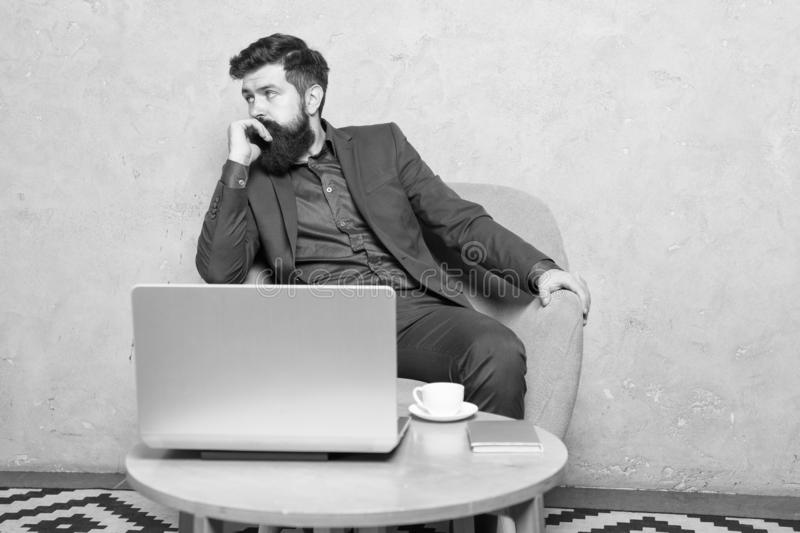Business correspondence. Modern businessman. Businessman work laptop. Man drink coffee in business office. Responding royalty free stock photography