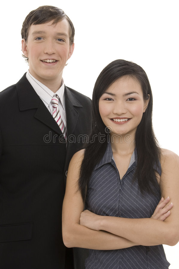 Business Couple 3. A businessman stands with a businesswoman, both wearing smart pinstriped suits royalty free stock image