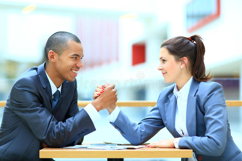 Business couple. Arm wrestling at the office royalty free stock images