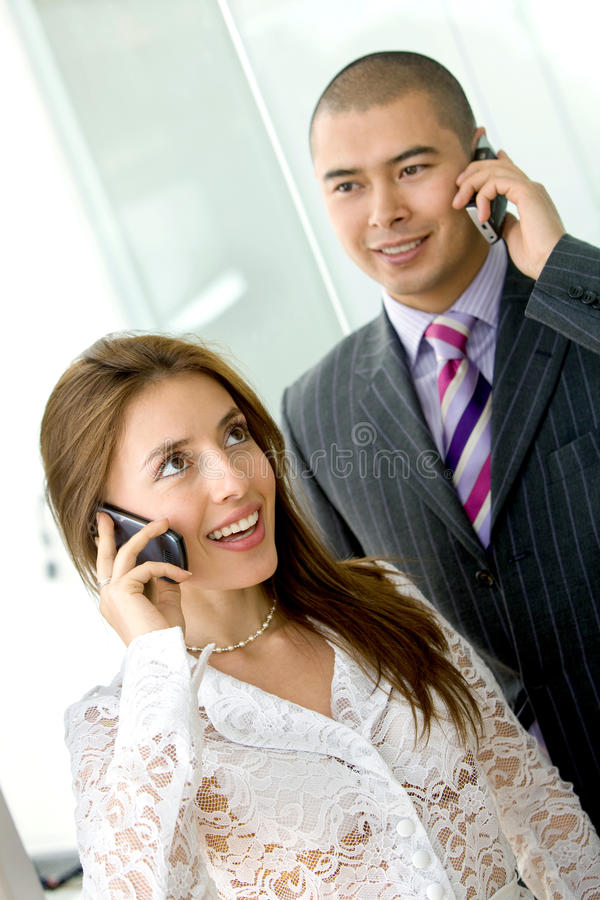 Business couple with cellular