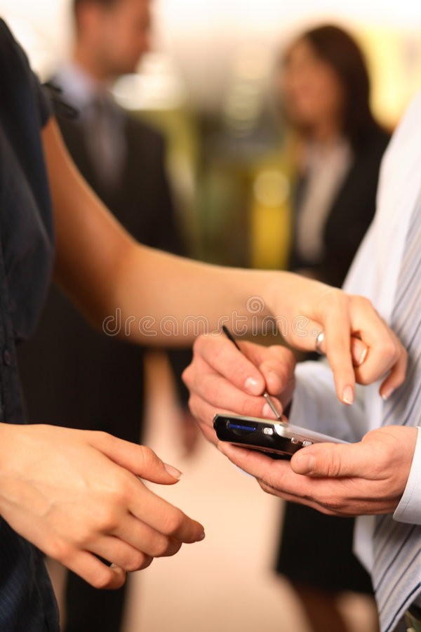 Business Couple Checking Schedule stock photography