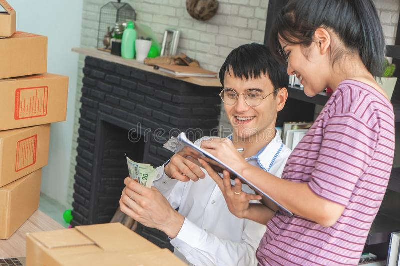 Business couple checking stock in their online home business. Business couple is checking stock in their online home business stock photos