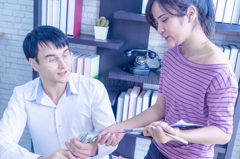 Business couple checking stock in their online home business royalty free stock image