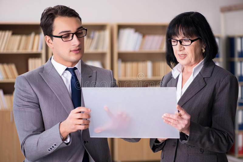 The business couple discussing business results on tablet. Business couple discussing business results on tablet royalty free stock photo