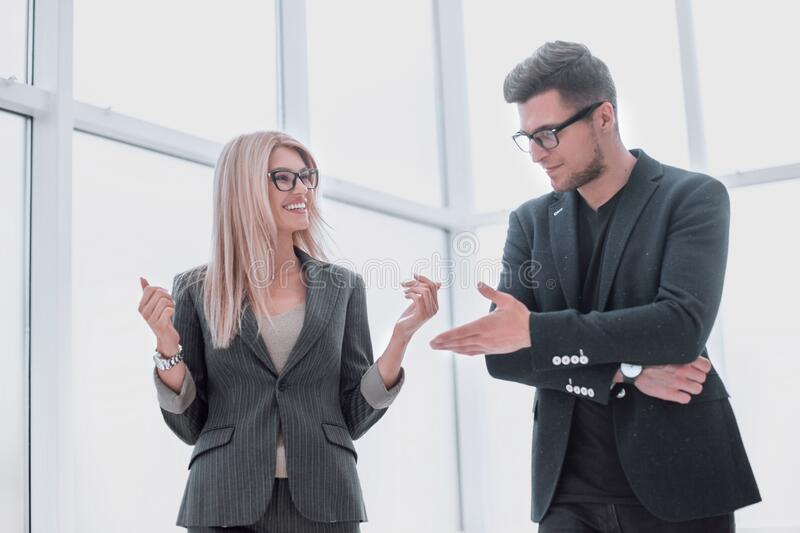 Business couple discussing something standing in the office royalty free stock image