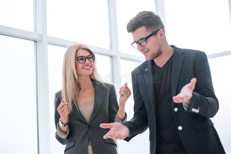 Business couple discussing something standing in the office royalty free stock images