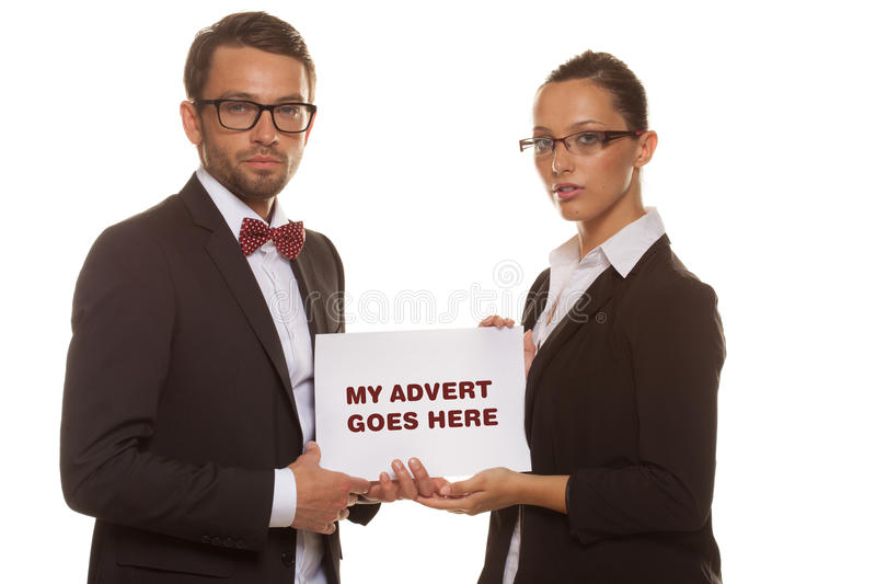 Business couple holding a white card stock photography