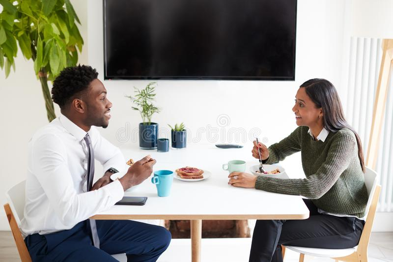 Business Couple At Home Eating Breakfast Before Leaving For Work stock image