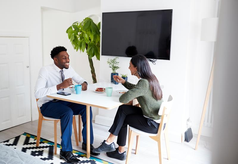 Business Couple At Home Eating Breakfast Before Leaving For Work royalty free stock photo