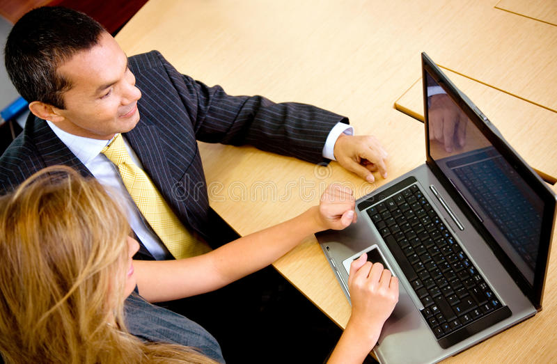 Download Business Couple On A Laptop Stock Image - Image of corporate, smiling: 15830359